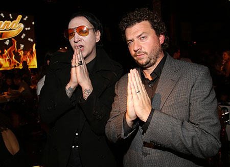 Musician Marilyn Manson, who makes a cameo in season four, and Danny McBride plot their next move at the reception